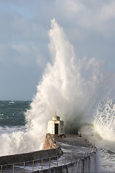 January 1, 2018 - Portreath, Cornwall, UK - Portreath, UK. Large waves crash into Portreath harbour wall and Portreath beach. The remainders of Storm Dylan have brought strong winds and heavy rainfall, and Storm Eleanor is due to arrive on Wednesday. (Credit Image: © Tom Nicholson/London News Pictures via ZUMA Wire)