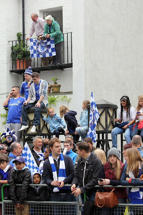Chelsea fans wait for the victory parade, celebrating their FA Cup and Champions League victories