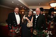 David Reid Chairman of Tesco, Mrs. Nicholas Bardswell and Brain Ross. The Royal Caledonian Ball 2007. Grosvenor House. 4 May 2007.  -DO NOT ARCHIVE-© Copyright Photograph by Dafydd Jones. 248 Clapham Rd. London SW9 0PZ. Tel 0207 820 0771. www.dafjones.com.