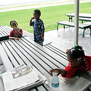 WEST PALM BEACH, FL - September 6, 2005:  My-Shelle Johnson, 8, front, Kevin Johnson the 4th, 5 yrs old, center, and Kevin Johnson the 5th, 2, pass time at a evacuation shelter in West Palm Beach, FL on Sept, 6, 2005. The shelter is called Palm Meadows and is a training facility for thoroughbred horses. The Johnson family evacuated New Orleans after being stranded for days in their flooded home and having to watch dead bodies float by. (Photo by Todd Bigelow/Aurora)