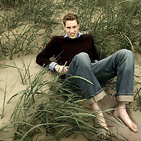Prince William sits on a beach in St Andrews after finishing his second year exams.Picture David Cheskin.Press Association