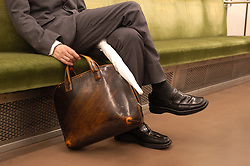 Detail of male commuter on Tokyo subway train
