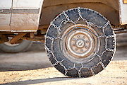 A hunting truck's tire with chains for snow and mud.