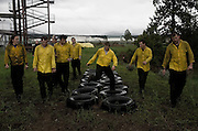 """""""Let's go! You can do it! C'mon!"""" shouts a chorus of Neds (rookie smokejumpers) as Michael Kolb runs through the tires at the end of an obstacle course at the smokejumper based in McCall, ID."""