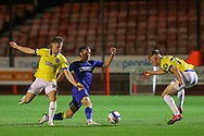 AFC Wimbledon midfielder Ethan Chislett (11) battles with Brighton and Hove Albion midfielder Ed Turns (72)  during the EFL Trophy Southern Group G match between AFC Wimbledon and Brighton and Hove Albion U21 at The People's Pension Stadium, Crawley, England on 22 September 2020.