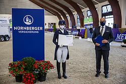 Kronberg, Gestüt Schafhof, KRONBERG _ Int. Festhallen Reitturnier Schafhof Edition 2020,<br /> <br /> KANERVA Emma (FIN), POLITYCKI Andreas (Vorstand Nürnberger Versicherung)<br /> - Siegerehrung -<br /> NÜRNBERGER BURG-POKAL der Dressurreiter 2020 - Finale<br /> Prix. St. Georges für 7-9j. Pferde <br /> Dressurprüfung Kl. S*<br /> <br /> 20. December 2020<br /> © www.sportfotos-lafrentz.de/Stefan Lafrentz
