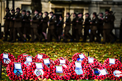 Soldiers from the Rifles walk past poppy wreaths during a Remembrance Sunday service in Queen's Square, Bristol, held in tribute for members of the armed forces who have died in major conflicts.