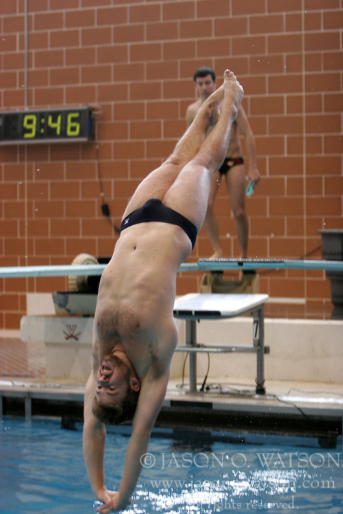 Eric Kelley dives off the 1m springboard.  University of Virginia Cavaliers Men's Swimming and Diving team competed against Tennessee and Princeton at the Aquatic and Fitness Center in Charlottesville, VA on January 14, 2006...