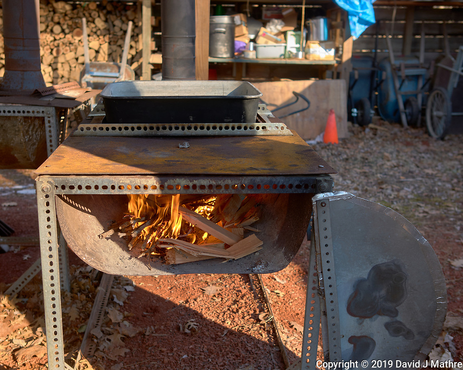 Starting the Fire. Maple Syrup Production. Image taken with a Leica CL camera and 23 mm f/2 lens.