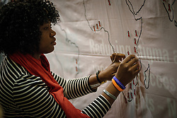 Participants attach pins to a map, indicating the places people lived, which they knew died from AIDS. During a July 19 interfaith prayer service, held at the Roman Catholic Emmanuel Cathedral in Durban, South Africa, during the 2016 International AIDS Conference.