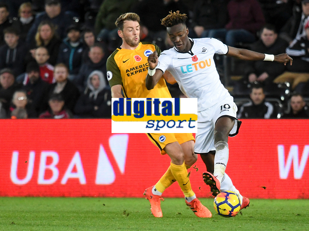 Football - 2017 / 2018 Premier League - Swansea City vs. Brighton & Hove Albion<br /> <br /> Tammy Abraham of Swansea City attacks, at The Liberty Stadium.<br /> <br /> COLORSPORT/WINSTON BYNORTH
