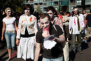 "Zombies eating joke severed limbs. Stoke Newington Zombie-a-thon. Hundreds of people joined together in protest in North London to demonstrate against the planned opening of a large Sainsbury's supermarket. Dressed up as zombies the protesters were making the point that they should keep local shops in the area and not have the high street ruined by large chains. The action by Stokey Local says: ""In Stoke Newington, even the dead are rising up to say 'no' to a proposed Sainsbury's development."" Walking slowly as if in a zombie film the march culminated in passing a Sainsbury's Local supermarket on the High Street. In the middle of June it was announced that a development is being planned for Wilmer Place, just beside Abney Park Cemetery on the corner of Church Street and the High Street – right in the heart of Stoke Newington. The proposed development comprises a large Sainsbury's supermarket and 44 homes and has significant implications for the diversity of the local economy, local employment, transport & traffic, noise and safety and local heritage."