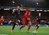 Georginio Wijnaldum of Liverpool cruises past Renan Lodi of Atletico Madrid  during the UEFA Champions League match at Anfield, Liverpool. Picture date: 11th March 2020. Picture credit should read: Darren Staples/Sportimage