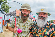 Hot work getting around the arena even with a pith helmet - The 2018 Latitude Festival, Henham Park. Suffolk 13 July 2018