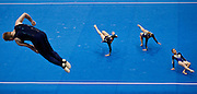 """""""The Art of Gymnastics""""<br /> Gymnasts is a celebration of the aesthetic beauty of the human form in a state of free flowing continuous movement and the way it  interacts with different apparatus often combining to create images with  an artistic, and sometimes, even surreal quality about them.<br /> These images were taken during the 2013 Australian Gymnastics Championships which were held at the Sydney Olympic Park Sports Centre in  July , at Homebush Bay.<br /> """"The Art of Gymnastics""""<br /> Gymnasts is a celebration of the aesthetic beauty of the human form in a state of free flowing continuous movement and the way it  interacts with different apparatus often combining to create images with  an artistic, and sometimes, even surreal quality about them.<br /> These images were taken during the 2013 Australian Gymnastics Championships which were held at the Sydney Olympic Park Sports Centre in  July , at Homebush Bay.<br /> <br /> Picture shows...Competitors in the Womens Artistic Gymnastics event warm up before the start of competition."""