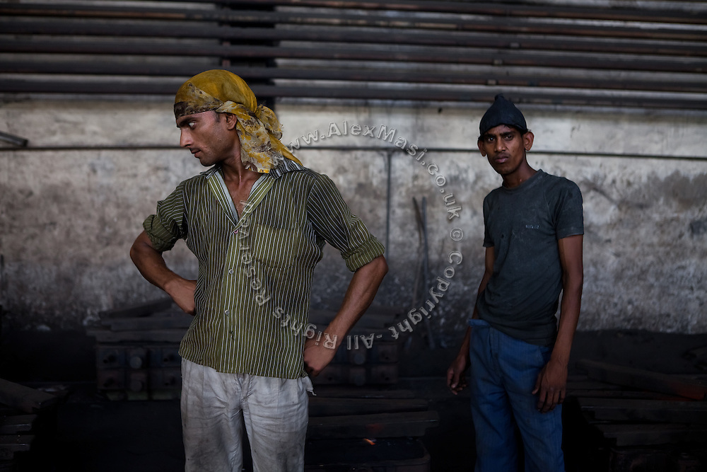 Young men are working inside a foundry in Agra, where regulations have imposed the use to electric rather than coal power. The Taj Mahal has been struggling to keep in shape also because of the high levels of pollution in the city, even after this switch in power.