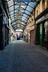 Barnsley Town Centre, Businesses in the The Victorian Arcade are closed and the Arcade is deserted half way through the UK's third week of emergency measures which were announced Monday the 23rd April <br /> <br /> At a regular intervals a public address system remind people they should stay at home - only leave the house for very limited purposes:<br /> shopping for basic necessities, and medicine. <br /> One form of exercise a day.<br /> Any medical need.<br /> Travelling for work purposes, but only where you cannot work from home.<br /> Time spent outside should be minimised<br /> and people should keep a safe distance of 2 meters apart from anyone outside of your household.<br /> <br /> 08 April 2020<br /> <br /> www.pauldaviddrabble.co.uk<br /> All Images Copyright Paul David Drabble - <br /> All rights Reserved - <br /> Moral Rights Asserted -