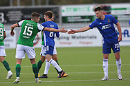 Kevin Nisbet (15) of Hibernian and Cove Rangers Jamie Masson (10) shake hands after the Betfred Scottish League Cup match between Cove Rangers and Hibernian at Balmoral Stadium, Aberdeen, Scotland on 10 October 2020.