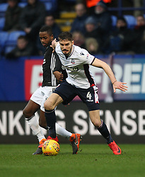 Dorian Dervite of Bolton Wanderers (R) tackles Ryan Sessegnon of Fulham - Mandatory by-line: Jack Phillips/JMP - 10/02/2018 - FOOTBALL - Macron Stadium - Bolton, England - Bolton Wanderers v Fulham - English Football League Championship
