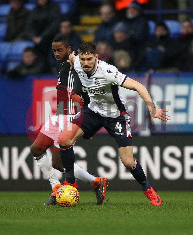 Dorian Dervite of Bolton Wanderers (R) tackles Ryan Sessegnon of Fulham - Mandatory by-line: Jack Phillips/JMP - 10/02/2018 - FOOTBALL - Macron Stadium - Bolton, England - Bolton Wanderers v Fulham - English Football League Championship