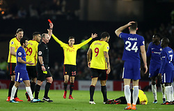 Match referee Mike Dean sends off Chelsea's Tiemoue Bakayoko (second right) during the Premier League match at Vicarage Road, Watford.