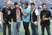Menudo; l to r: Jose Bordonada Collazo, Carlos Olivero, Emmanuel Valez Pagan, Monti Montanez, and Chris Moy at The 2008 Arthur Ashe Kids' Day held at The USTA Bille Jean King National Tennis Center on August 23, 2008 in Flushing, NY
