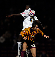 Photo: Jed Wee/Sportsbeat Images.<br /> Bradford City v Hereford United. Coca Cola League 2. 29/12/2007.<br /> <br /> Hereford's Toumani Diagouraga jumps above Bradford's Kyle Nix to win the ball.