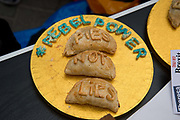 Anti Brexit protesters outside Parliament, Westminster, London as Members of Parliament debate the European Union withdrawal bill, June 20th 2018. A plate of home-made pies with the words rebel power and pies not lies on them.