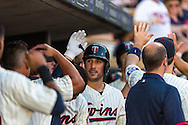Trevor Plouffe #24 of the Minnesota Twins is congratulated in the dugout after hitting a home run against the Detroit Tigers on June 15, 2013 at Target Field in Minneapolis, Minnesota.  The Twins defeated the Tigers 6 to 3.  Photo: Ben Krause
