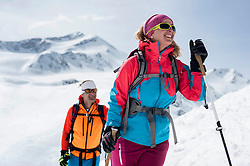 Portrait couple cross-country skiing Alps