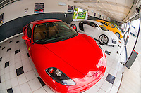 A garage with Ferraris, Audis, Lamborghinis, etc. at Exotic Rides Mexico. Exotic Rides Mexico gives the opportunity for guests to drive the most exotic and exclusive cars in the world on a 1.1 mile private race track in Cancun, Quintana Roo, Mexico