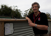 Associate Professor Greg Woods, an immunologist from the University of Tasmania's Menzies Research Institute and the Save the Tasmanian Devil Program pictured at enclosure containing some of the quarantined insurance populations of Tasmanian Devils. In the wild, tasmanian devils have become endangered due to a contagious cancer which causes facial tumours, causing the animals to starve to death. In December 2009, Woods announced that he and other researchers had found  that the disease may be related a peripheral nerve cell, called the Schwann cell, which has led some hopes for preserving the devil, at least in terms of quarantine insurance populations.
