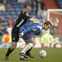 Photo: Aidan Ellis.<br /> Oldham Athletic v Swansea City. Coca Cola League 1. 22/04/2006.<br /> oldham's Mark Hughes holds off swansea's Kevin Mcleod