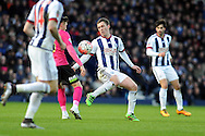 West Brom's Craig Gardner (c) handles the ball away from the Peterborough player. The Emirates FA Cup, 4th round match, West Bromwich Albion v Peterborough Utd at the Hawthorns stadium in West Bromwich, Midlands on Saturday 30th January 2016. pic by Carl Robertson, Andrew Orchard sports photography.