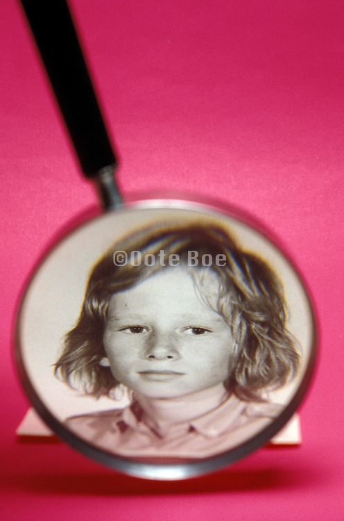 vintage photograph of boy shown through magnifying glass