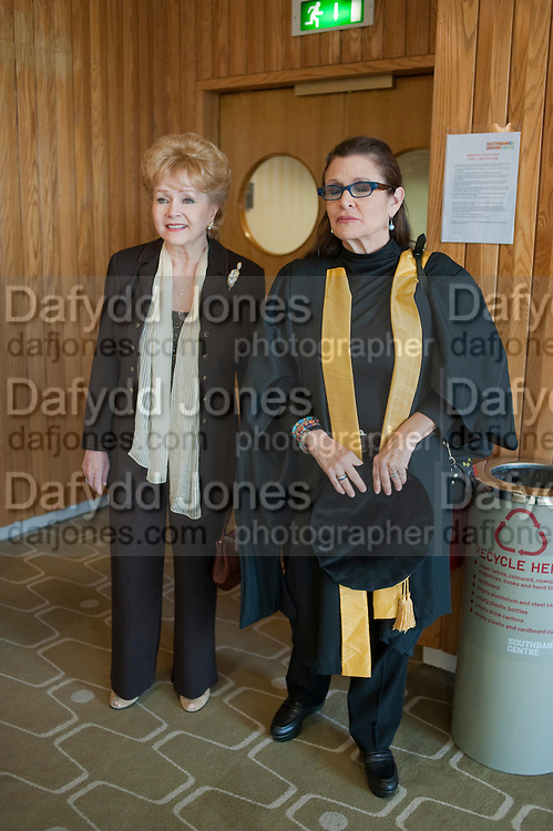 DEBBIE REYNOLDS; CARRIE FISHER, CARRIE WAS A STUDENT OF THE CENTRAL AND WAS  BE PROPOSED BY HER MOTHER. Central School of Speech and Drama presents Honory Fellowships to Carrie Fisher, Bette Bourne, Joseph Selig and Helen Lannaghan. Royal Festival Hall. London. 12 December 2011.