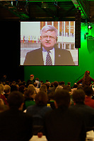 29 NOV 2003, DRESDEN/GERMANY:<br /> Joschka Fischer, B90/Gruene, nimmt per Life-Schaltung auf eine Grossbildleinwand am Parteitag teil, 22. Ordentliche Bundesdelegiertenkonferenz Buendnis 90 / Die Gruenen, Messe Dresden<br /> IMAGE: 20031129-01-044<br /> KEYWORDS: Bündnis 90 / Die Grünen, BDK, Rede, speech, screen, Leinwand, Display, Delegierte<br /> Parteitag, party congress, Bundesparteitag