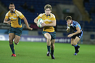 Cardiff Blues v Australia at the Cardiff City Stadium on Tuesday 24th Nov 2009. pic by Andrew Orchard, Andrew Orchard sports photography. James O'Connor of Australia makes a break.