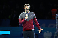 Switzerland's Roger Federer announces his withdrawal due to injury during the Mens Doubles Final of the Barclays ATP World Tour Finals, O2 Arena, London, United Kingdom on 16 November 2014 © Pro Sports Images