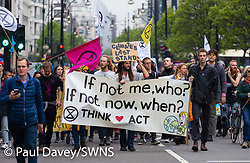 A group of activists makes their way along Oxford Street, coming from the tented camp at Marble Arch as hundreds of environmental protesters from Extinction Rebellion occupy Oxford Circus, a pink yacht being the focal point of their presence, with traffic denied access to two of London's busiest streets. London, April 16 2019.