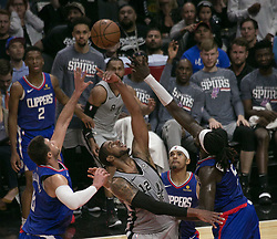 November 15, 2018 - Los Angeles, California, U.S - LaMarcus Aldridge #12 of the San Antonio Spurs and Montrezl Harrell #5, Danilo Gallinari #8 and Tobias Harris #34 of the Los Angeles Clippers reach for the ball during their NBA game on Thursday November 15, 2018 at the Staples Center in Los Angeles, California. (Credit Image: © Prensa Internacional via ZUMA Wire)