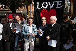 """© Licensed to London News Pictures . 16/08/2015 . Manchester , UK . CHRISTOPHER ECCLESTON , JOHN THOMSON , JOHN HENSHAW amongst people reading an account of the """" Peterloo """" massacre at a memorial at the site of St Peter's Field , where fifteen people were killed during a cavalry charge on a democracy protest , 196 years ago (16th August 1819) . Photo credit : Joel Goodman/LNP"""