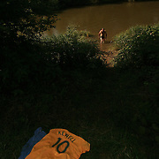 Soccer World Cup  ,   Australian socceroos fan camp in Ohrnberg  , a town a few kilometers from The Aussie team training camp. Chad Eggelton ducks in for a wash by the local river.  Fairfax Picture by Vince Caligiuri, The Age Melbourne. Saturday 10th   June 2006.