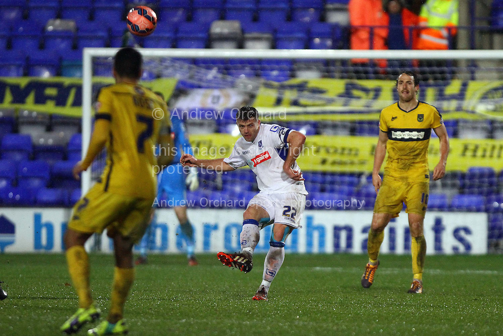 Steve Jennings of Tranmere Rovers (c) passes the ball upfield. The FA Cup, 2nd round replay, Tranmere Rovers v Oxford United at Prenton Park in Birkenhead, England on Tuesday 16th December 2014.<br /> pic by Chris Stading, Andrew Orchard sports photography.