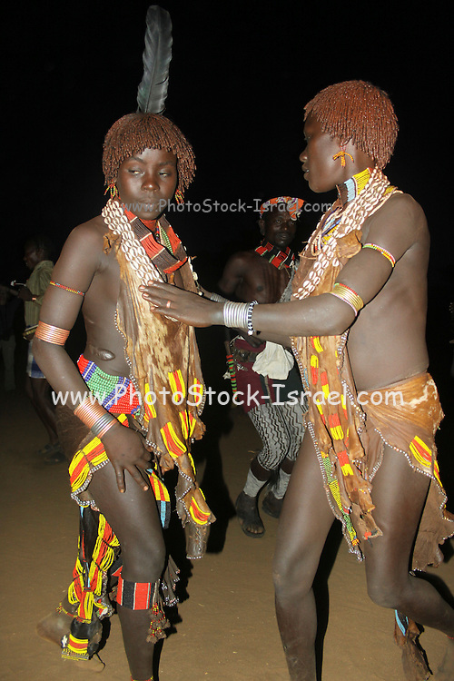 Africa, Ethiopia, Omo River Valley, Women of the Hamer Tribe in tribal dance The hair is coated with ochre mud and animal fat