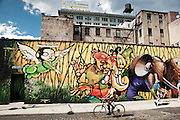 Street art covering an entire wall of Water street in DUMBO, Brooklyn, New York, 2009.