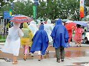 Shunyi, CHINA.  Spectators, flood away from Shunyi Rowing Course, after the afternoons racing is cancelled, due to adverse weather conditions at the  2008 Olympic Regatta, . Thursday 14.08.2008  [Mandatory Credit: Peter SPURRIER, Intersport Images]