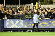 Steward struggling to hold bam Milton Keynes Dons fans after scoring during the EFL Sky Bet League 1 match between AFC Wimbledon and Milton Keynes Dons at the Cherry Red Records Stadium, Kingston, England on 22 September 2017. Photo by Matthew Redman.