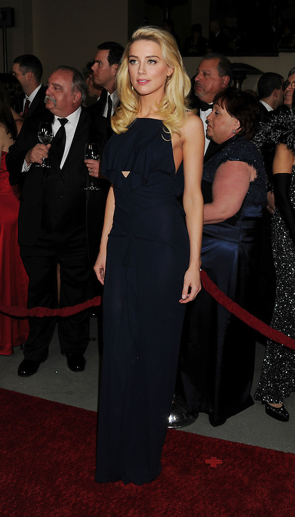 HOLLYWOOD, CA - JANUARY 28: Amber Heard arrives at the 64th Annual Directors Guild Of America Awards at the Grand Ballroom at Hollywood & Highland Center on January 28, 2012 in Hollywood, California.