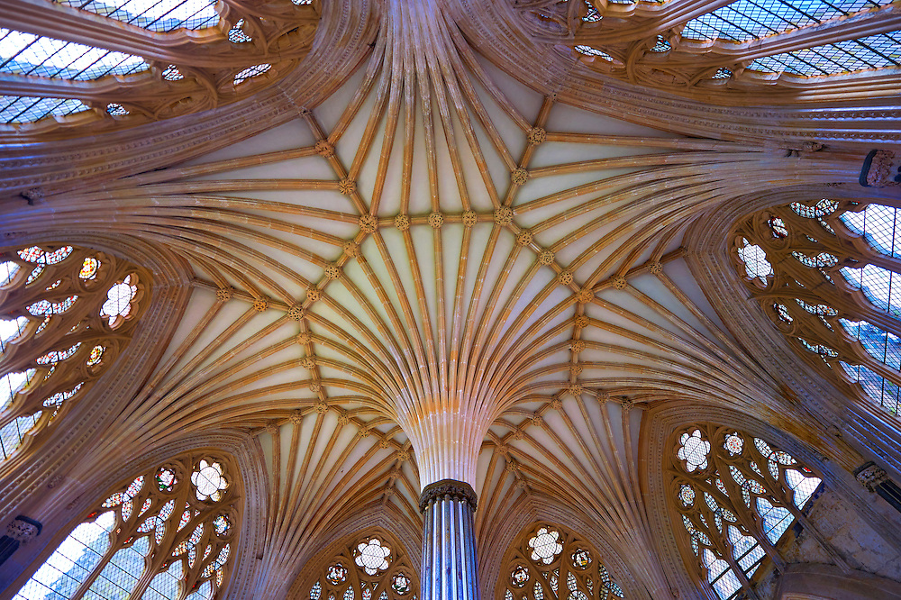 """Interior vaulted roof of the Chapter House of the the medieval Wells Cathedral built in the Early English Gothic style in 1175, Wells Somerset, England . Its Gothic architecture is mostly in Early English style of the late 12th – early 13th centuries. Building began about 1175 at the east end with the choir. Historian John Harvey sees it as Europe's first truly Gothic structure. Its Early English front with 300 sculpted figures, is seen as a """"supreme triumph of the combined plastic arts in England"""".<br /> <br /> Visit our MEDIEVAL PHOTO COLLECTIONS for more   photos  to download or buy as prints https://funkystock.photoshelter.com/gallery-collection/Medieval-Middle-Ages-Historic-Places-Arcaeological-Sites-Pictures-Images-of/C0000B5ZA54_WD0s"""